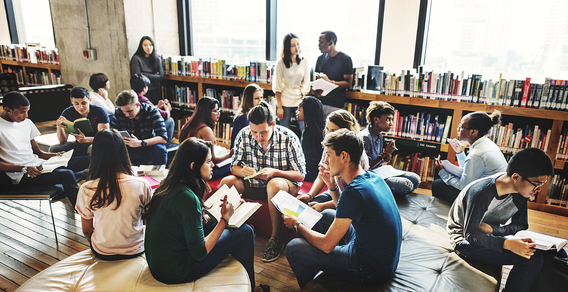 group of student are studying at the library